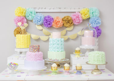 Rows of cupcakes and cakes on dessert table; Toronto, Ontario, Canada
